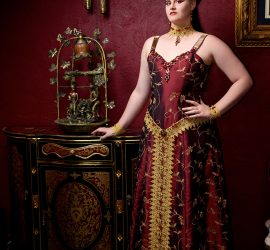 Royal embroidered and beaded evening gown, burgundy and gold.