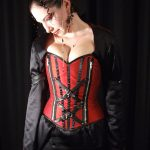 Red silk corset and embroidered black gown